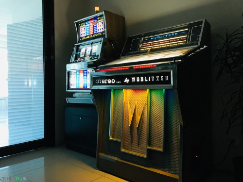 WURLITZER JUKEBOX AND DOUBLE BLACK TIE SLOT MACHINE
